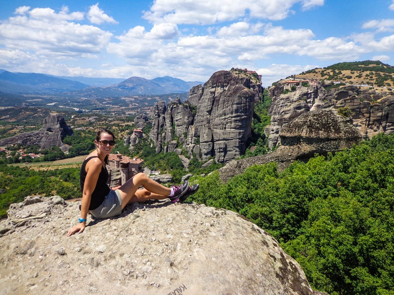 Anna sitting on a rock in Meteora Greece